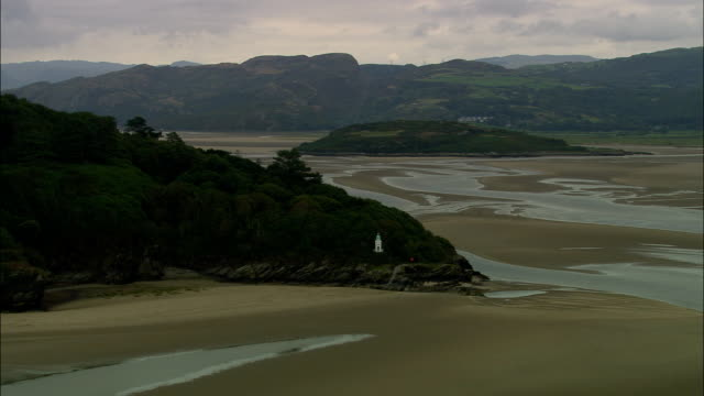 portmeirion approach and unique village  - aerial view - wales, caernarfonshire and merionethshire, united kingdom - wales stock videos & royalty-free footage