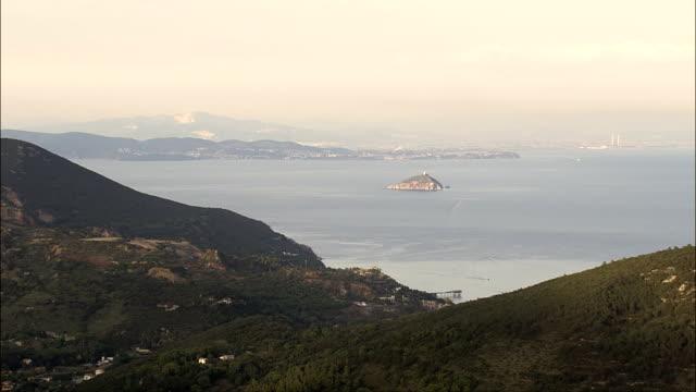 porto azzurro at dusk  - aerial view - tuscany, provincia di livorno, porto azzurro, italy - island of elba stock videos & royalty-free footage