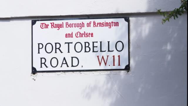 portobello road establishing shot. famous street market area of london. - sign stock videos & royalty-free footage