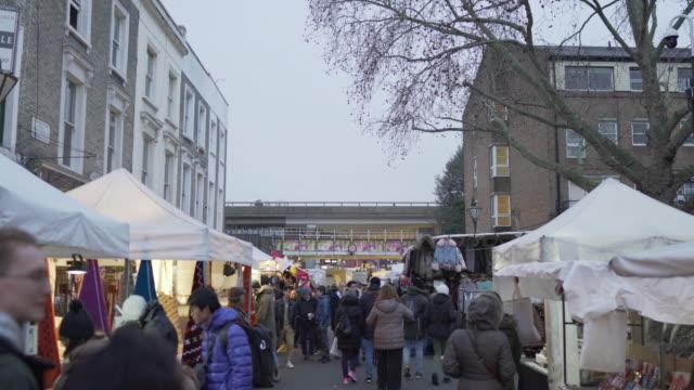 portobello road, london on a winter evening - notting hill videos stock videos & royalty-free footage