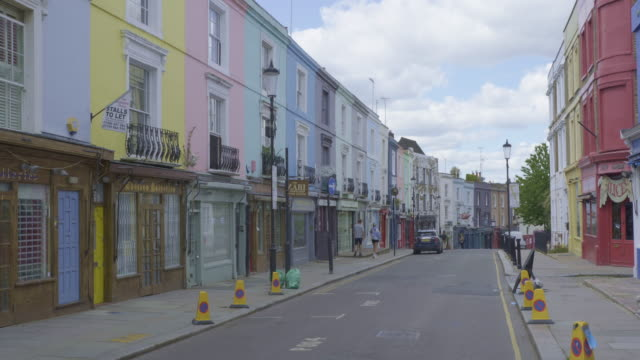 portobello road on market day is sparse of people and traffic during the coronavirus pandemic on may 02 2020 in london england the uk remains in full... - distant stock videos & royalty-free footage