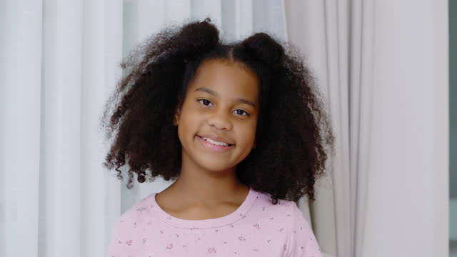 portrait african ethnicity of girl age 9 years old smiling looking at camera to prevent epidemics of coronavirus or covid-19 at home.home studio concept. - 8 9 years stock videos & royalty-free footage