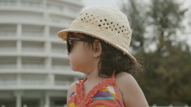 portrait asian baby on hua hin beach - baby girls stock videos & royalty-free footage