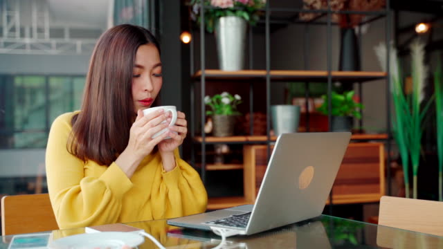 portrait asian beautiful girl or women hands using computer for business in workplace . asian women aged 20-30 years, raised a glass to drink more coffee. - coffee drink stock videos & royalty-free footage