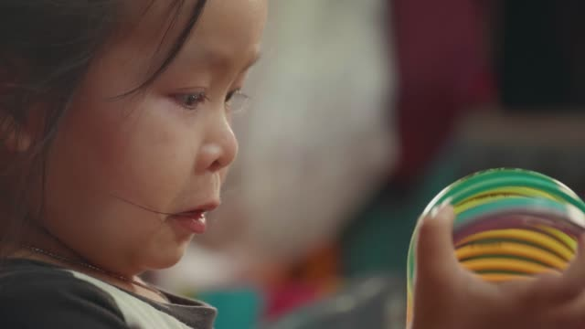 portrait asian girl playing toy but look sad and crying. so cute. - baby girls stock videos & royalty-free footage