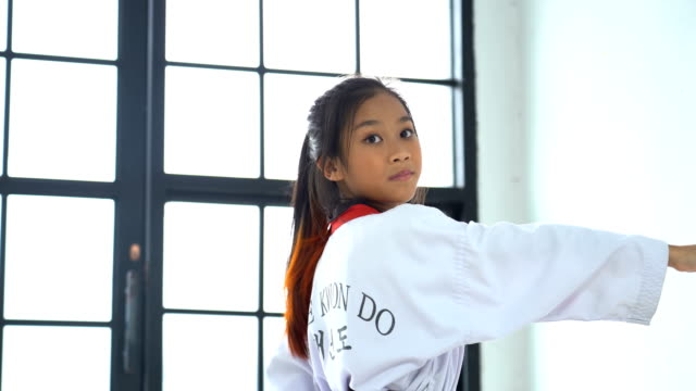portrait asian girl taekwondo in studio - girls stock videos & royalty-free footage