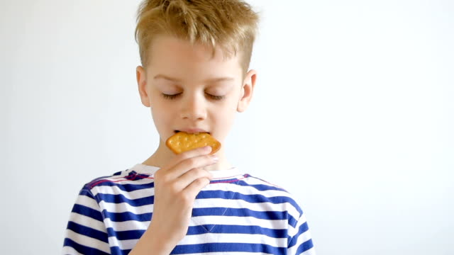 portrait boy eating cookies, close-up - cracker stock videos and b-roll footage
