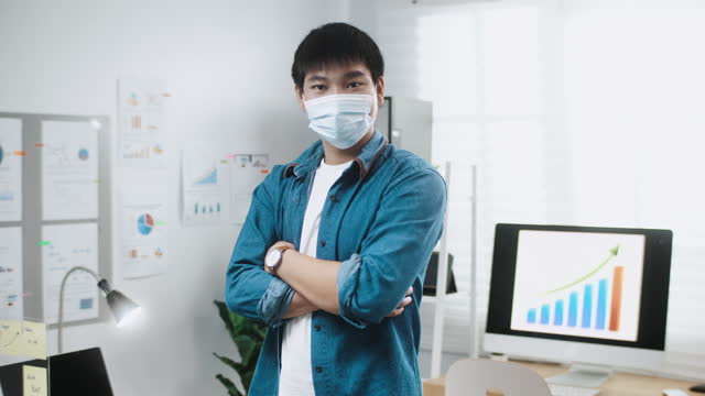 portrait businessman wearing face mask in office - safety stock videos & royalty-free footage