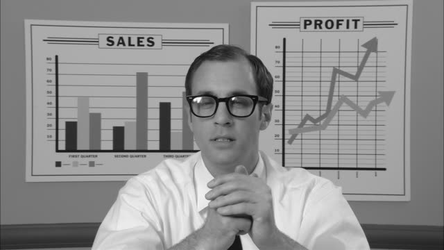 b/w cu portrait businessman with glasses looking contemplative/ man picking up pencil and chewing on it as he things/ man smiling/ new york city - hemd und krawatte stock-videos und b-roll-filmmaterial