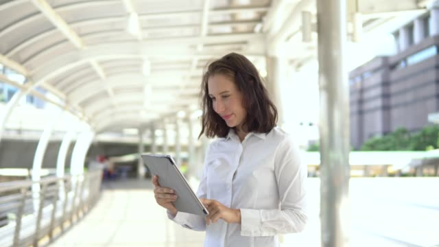 portrait confident young businesswoman using digital tablet - holding stock videos & royalty-free footage