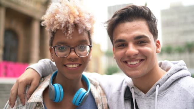 portrait couple embracing in the city - person in education stock videos & royalty-free footage