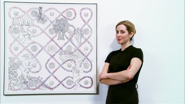 vídeos y material grabado en eventos de stock de portrait gallerist standing next to painting hanging on wall with arms crossed - museo de arte