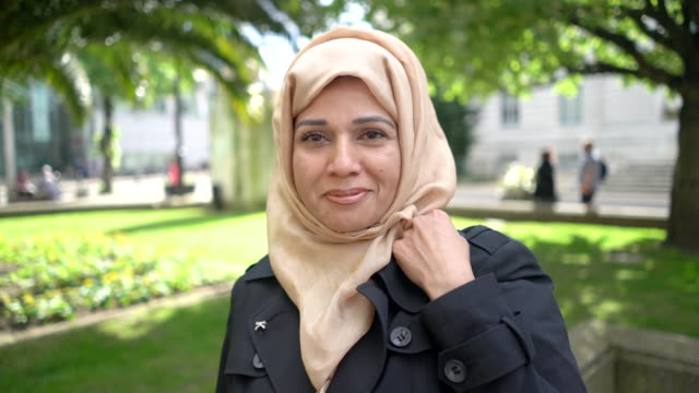 a portrait headshot of a muslim woman - scarf stock videos & royalty-free footage