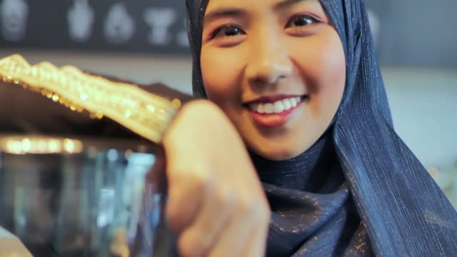 portrait islamic woman small business owner. muslim entrepreneur concept.arab youth - girls stock videos & royalty-free footage