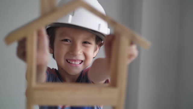 portrait little boy with safety helmet :engineer concept - building activity stock videos & royalty-free footage