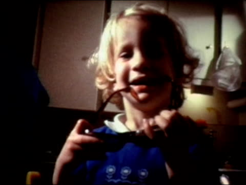 1975 portrait little girl playing with big sunglasses - 1975 stock videos & royalty-free footage