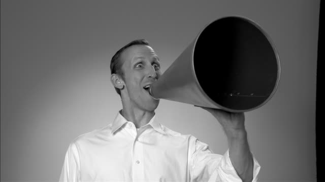 b/w ms portrait man shouting into old-fashioned megaphone and giving a thumbs up and big smile to camera/ new york city  - megaphone stock videos & royalty-free footage