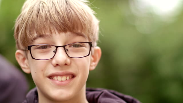 portrait of 11 years old boy with eyeglasses - boys stock videos & royalty-free footage