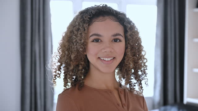 portrait of 17 year old mixed race girl in home interior - 30 seconds or greater stock videos & royalty-free footage