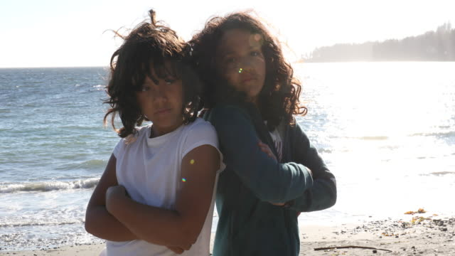 portrait of 2 young mixed race girls, looking 'tough' - mixed race person stock videos & royalty-free footage