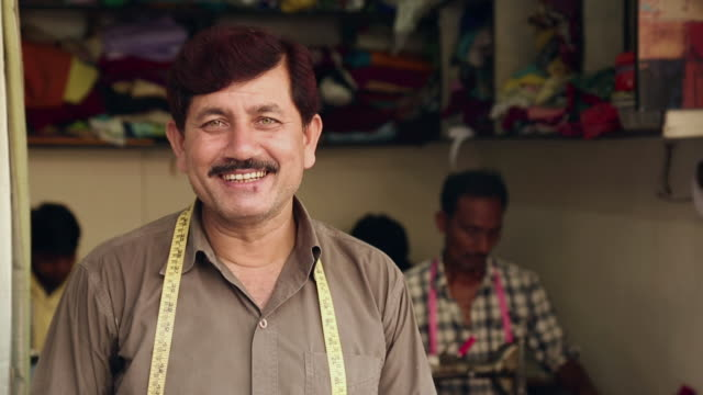 portrait of a adult man smiling, haryana, india - moustache stock videos and b-roll footage