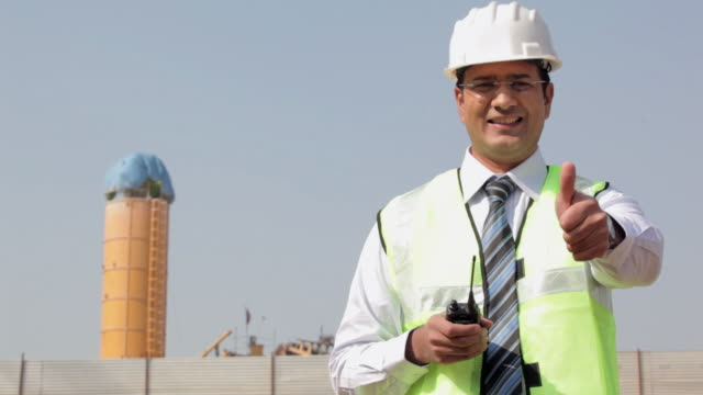 Portrait of a architect showing thumbs up, Delhi, India