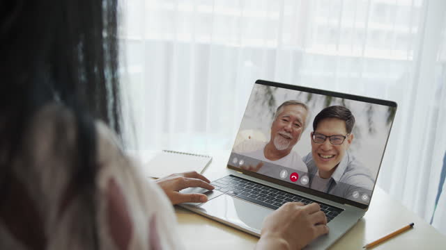 portrait of a beautiful asian woman using laptop, asia girl chatting with his family through a video call in living room at her home - video portrait stock videos & royalty-free footage