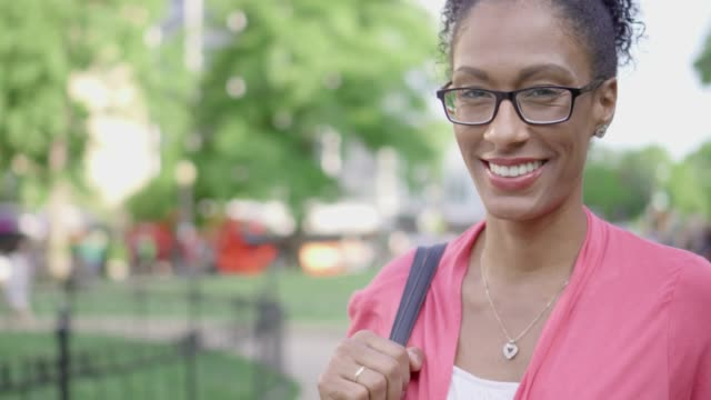 portrait of a beautiful mixed-race woman smiling at the camera - only mature women stock videos and b-roll footage