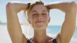 Portrait of a beautiful young woman on the beach