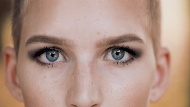 ds cu portrait of a beautiful young woman with blue eyes - make up stock videos & royalty-free footage