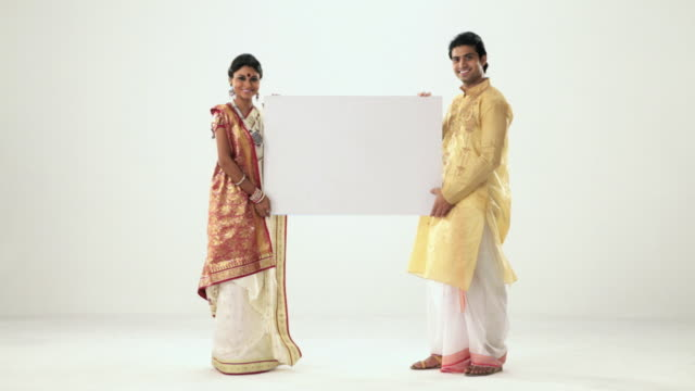 Portrait of a bengali couple showing a placard