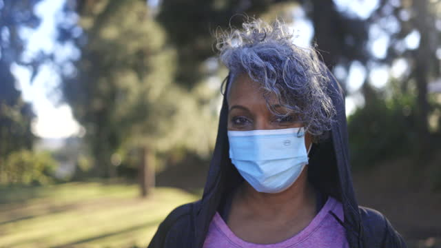 portrait of a black woman wearing a mask - headshot stock videos & royalty-free footage