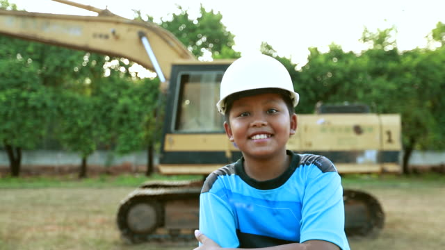 portrait of a boy asian in with safety helmet. the concept of boy dream engineering - contractor stock videos and b-roll footage