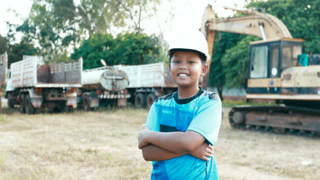 portrait of a boy asian in with safety helmet. the concept of boy dream engineering - adult imitation stock videos and b-roll footage