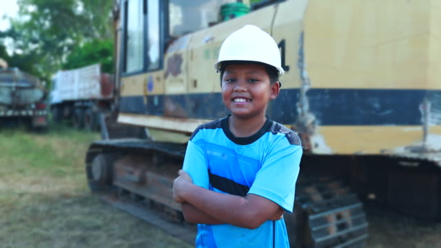 portrait of a boy asian in with safety helmet. the concept of boy dream engineering, slow motion - adult imitation stock videos and b-roll footage