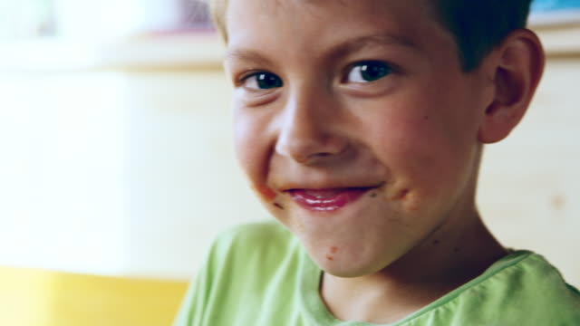 cu portrait of a boy cleaning his mouth after eating - boys stock videos & royalty-free footage