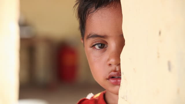 portrait of a boy crying, faridabad, haryana, india  - poverty stock videos & royalty-free footage