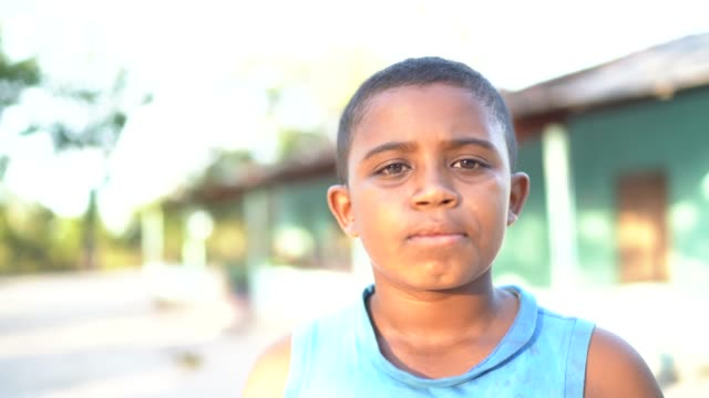 portrait of a boy outdoors in a rural scene - tocantins stock videos and b-roll footage