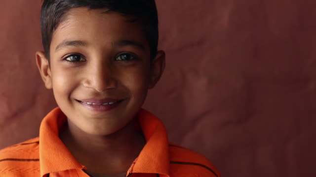 portrait of a boy smiling, ballabhgarh, haryana, india - インド人点の映像素材/bロール