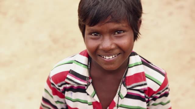 Portrait of a boy smiling, Haryana, India