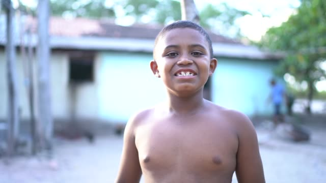 portrait of a boy without shirt outdoors in a rural scene - wattle and daub stock videos and b-roll footage