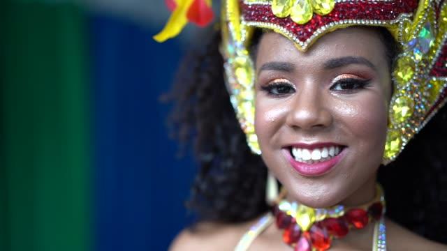 portrait of a brazilian woman wearing carnival costume - mardi gras stock videos and b-roll footage
