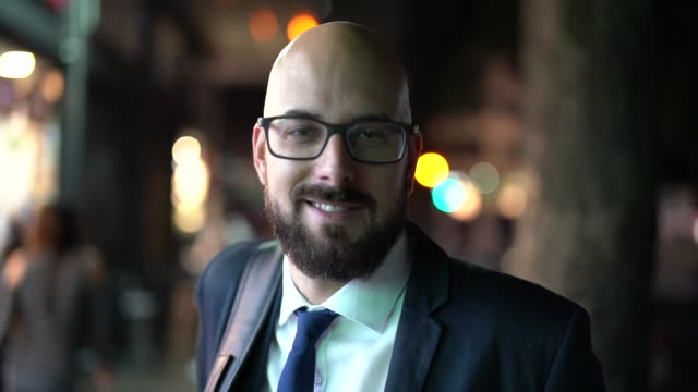 portrait of a business man at night city - completely bald stock videos and b-roll footage
