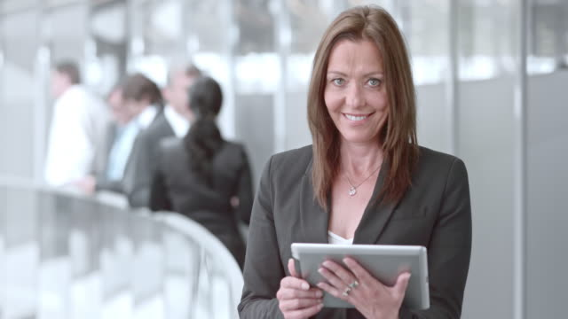DS Portrait of a business woman working on a tablet and smiling