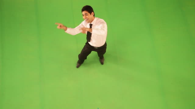portrait of a businessman dancing  - coloured background stock-videos und b-roll-filmmaterial