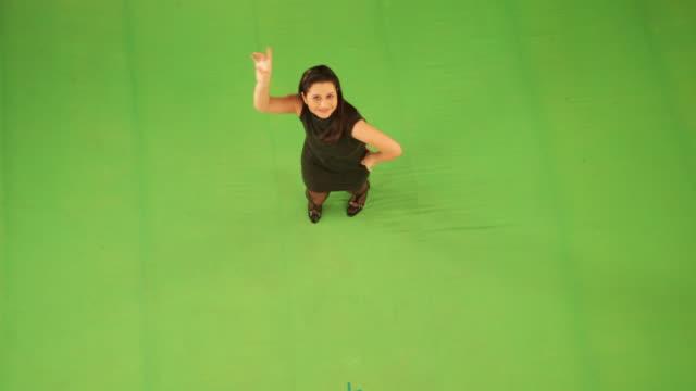 Portrait of a businesswoman dancing