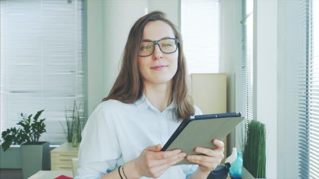 Portrait of a businesswoman holding a digital tablet.