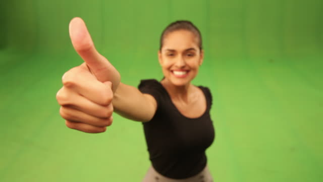 portrait of a businesswoman showing her thumb  - thumbs up stock videos & royalty-free footage