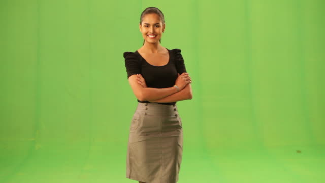 vidéos et rushes de portrait of a businesswoman standing with her arms crossed  - fond vert