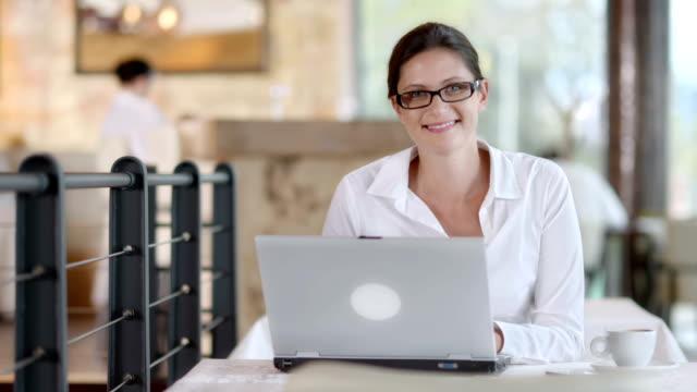 HD: Portrait Of A Businesswoman Using Laptop